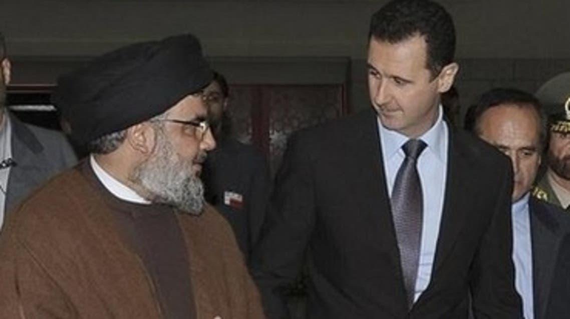 Hezbollah leader Hassan Nasrallah and Syrian President Bashar Assad