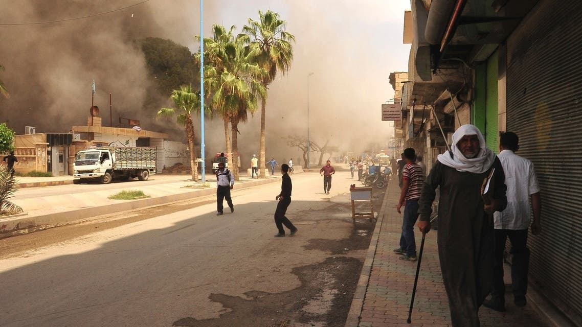 People run for cover after what activists said was shelling by forces loyal to Syria's President Bashar al-Assad in Raqqa province, eastern Syria May 3, 2013. (Reuters)