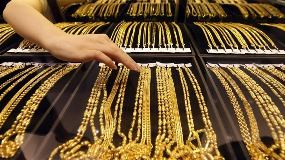 Gold prices eased by 0.6 percent after rising to a near three-week high of $1,487.80 on Friday. (Reuters)