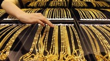 Gold prices lower as equities make gains