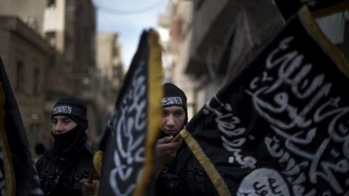 Members of Liwa Hamzah, an Islamist brigade hold flags of Jabhat al-Nusra. AFP photo