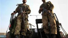 As Pakistan votes, the military watches from its barracks