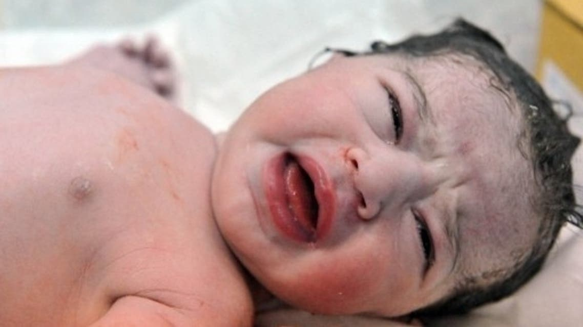 A Moroccan new born baby is pictured on October 31, 2011 at Orangers maternity in Rabat. (FILE PHOTO AFP)