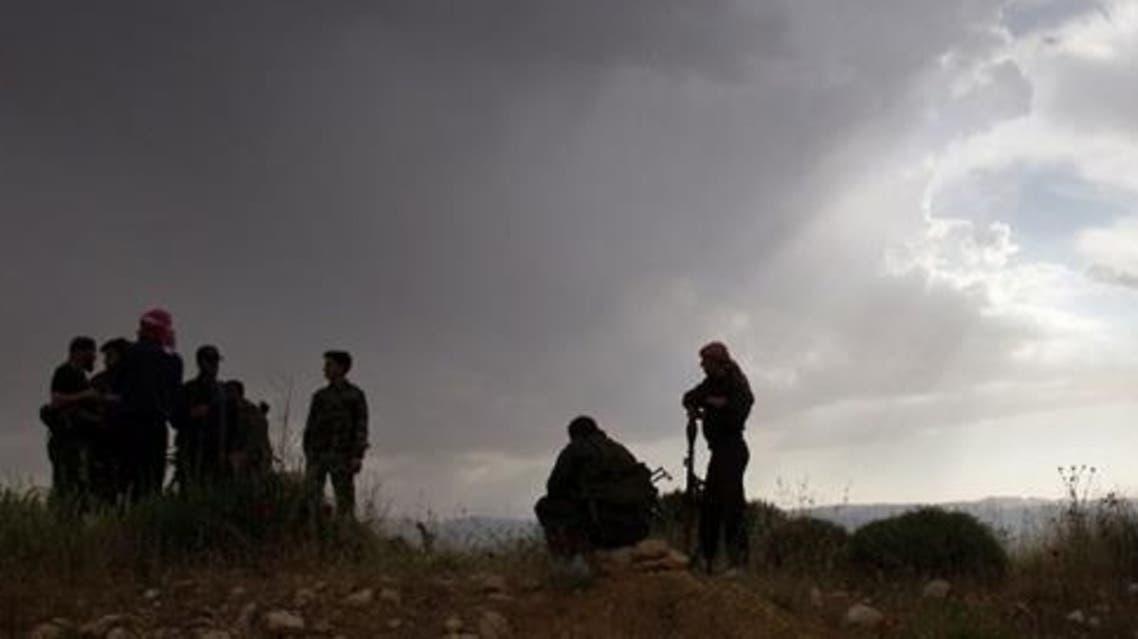 Syrian rebels take up position outside Al-Qusayr. (AFP)
