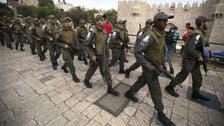 Israeli police guard women praying at Jewish site