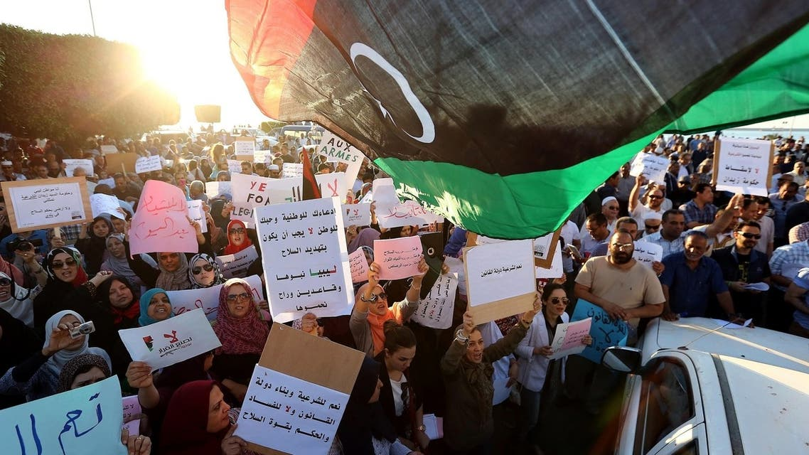 Hundreds of Libyans demonstrate outside the foreign ministry to demand the lifting of the siege by armed gunmen and the return of the rule of law during a protest in Tripoli on May 10, 2013. (AFP)