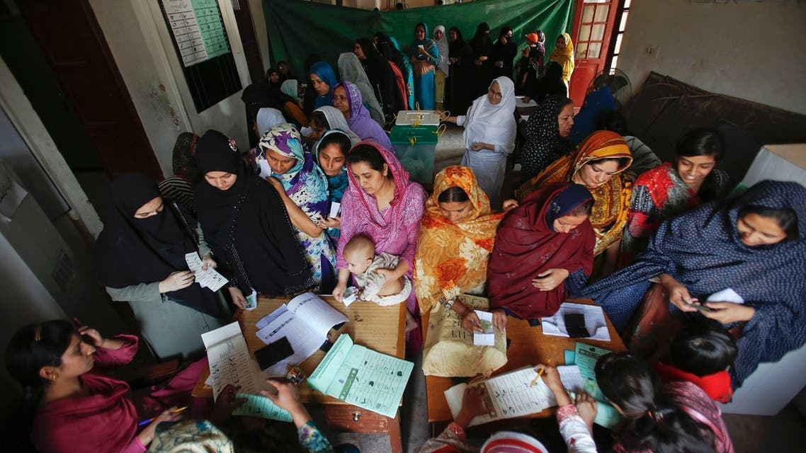 Women register and cast their ballots at a polling station in the old part of Lahore May 11, 2013. (Reuters)