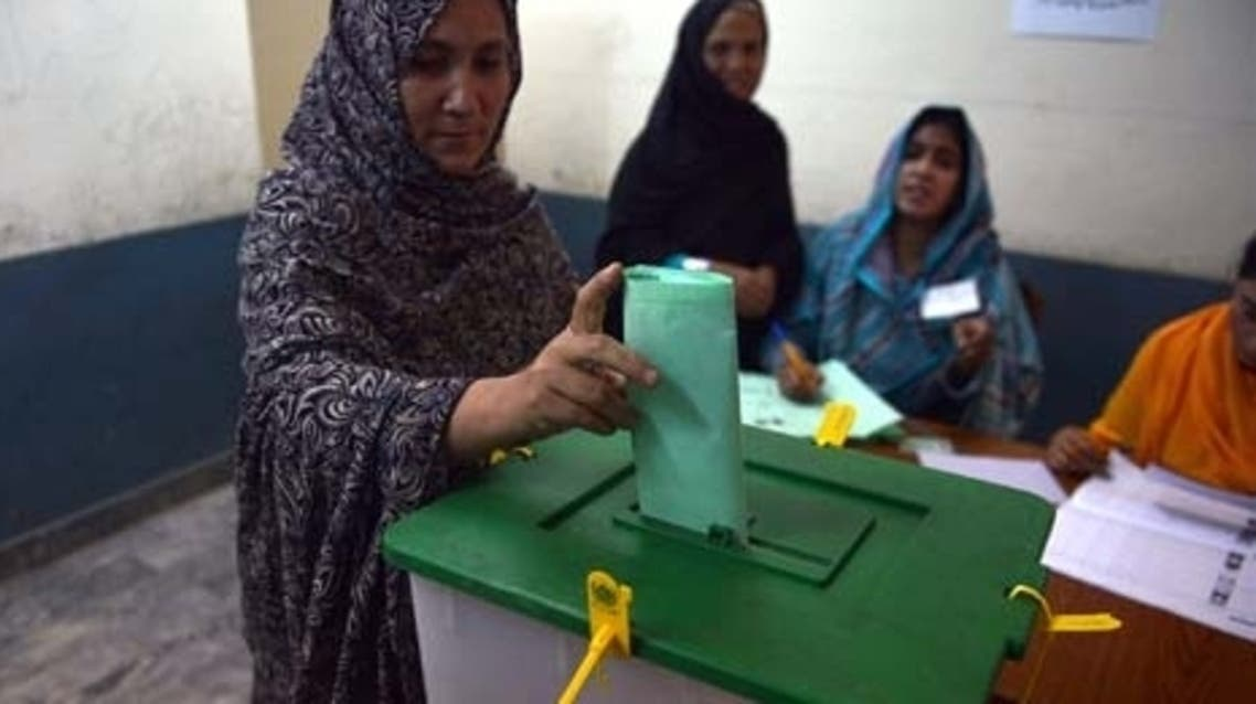 A Pakistani woman casts her vote at a polling station in Islamabad. (AFP)