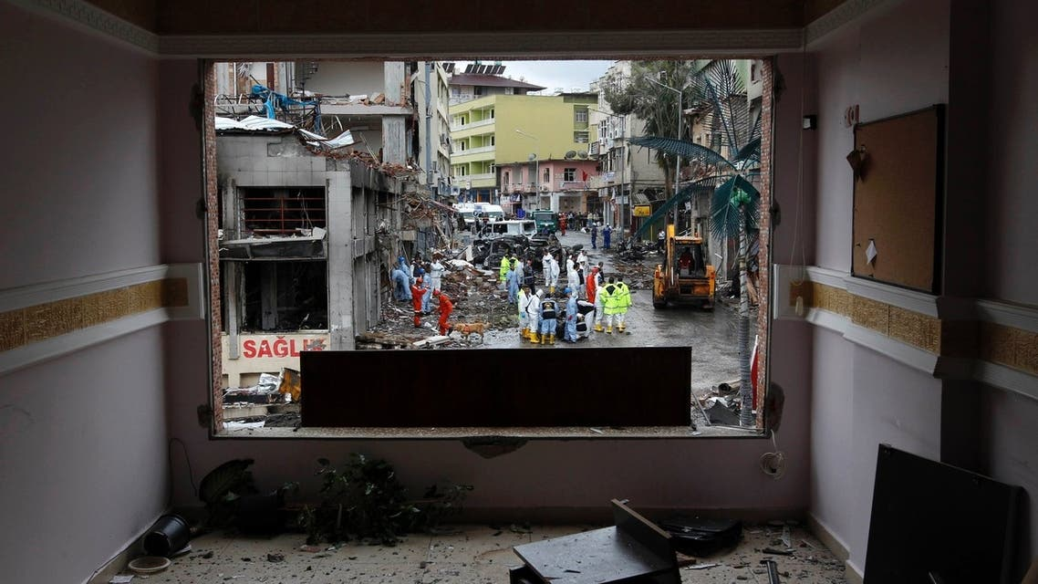 One of the scenes of the twin car bomb attacks seen through a damaged building in the town of Reyhanli of Hatay province near the Turkish-Syrian border May 12, 2013.