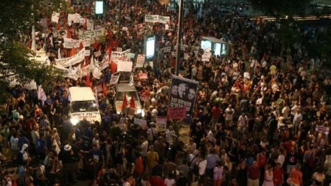 Israelis march in the center of Tel Aviv on July 30, 2011. Photo by AFP