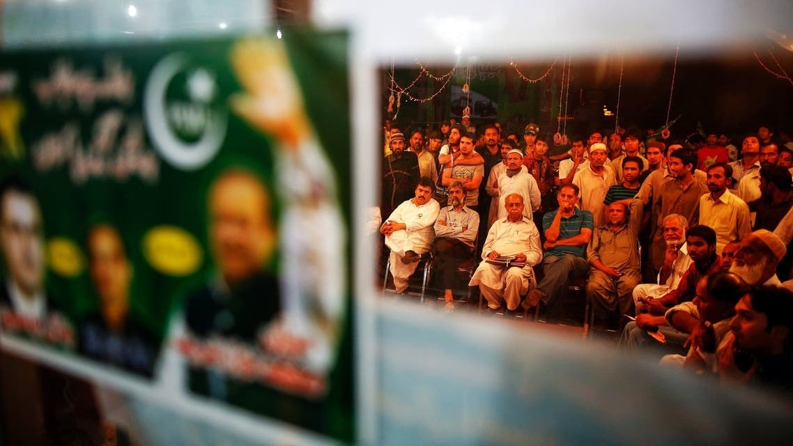 Supporters of the Pakistan Muslim League - Nawaz (PML-N) gather at the party headquarters to watch news after polling stations closed on election day in Lahore May 11, 2013. (Reuters)