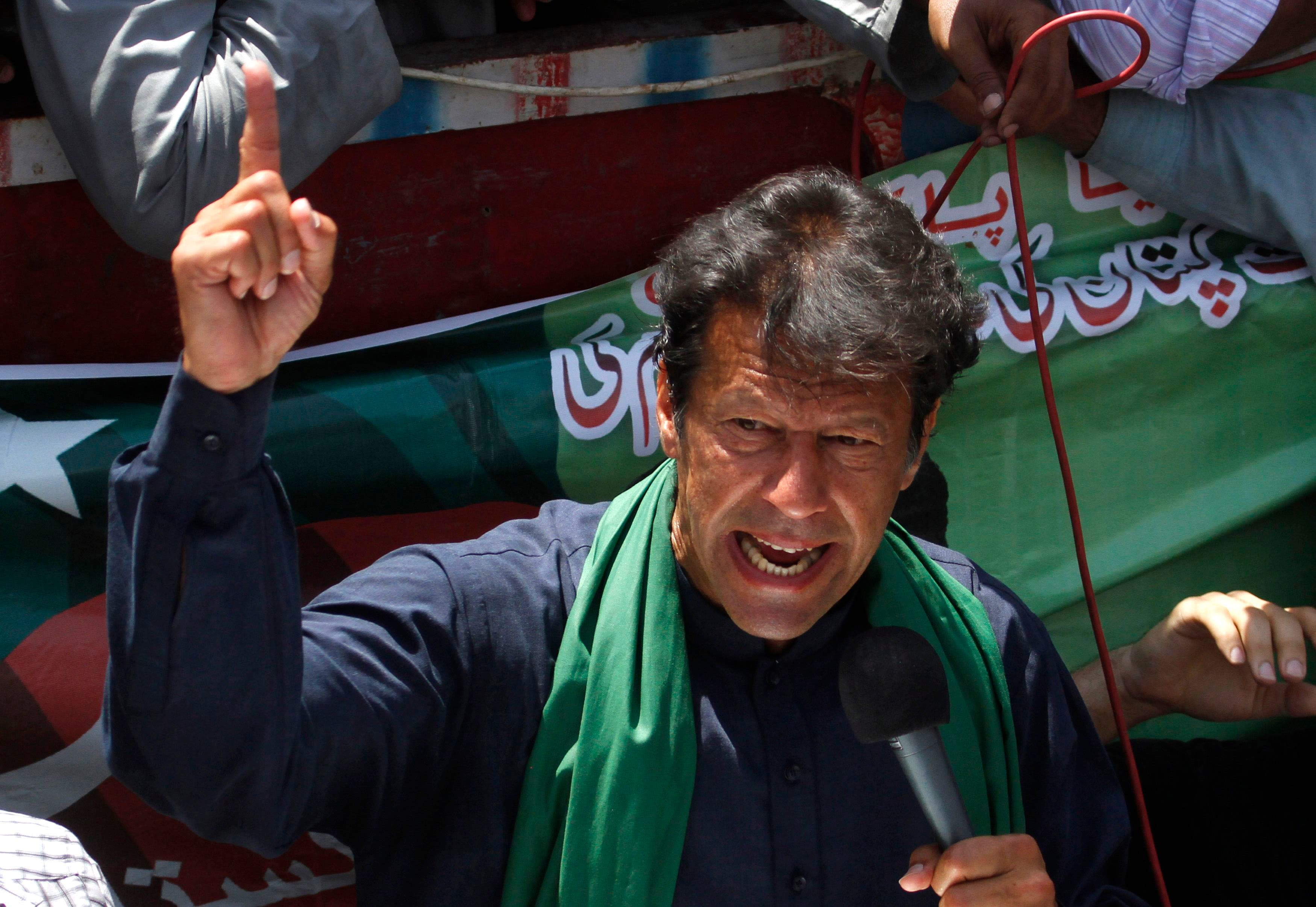 Imran Khan, Pakistani cricketer-turned-politician and chairman of political party Pakistan Tehreek-e-Insaf (PTI), addresses his supporters after his visit to mausoleum of Mohammad Ali Jinnah, founder and first governor-general of Pakistan, during an election campaign in Karachi in this May 7, 2013 file photo. (REUTERS)