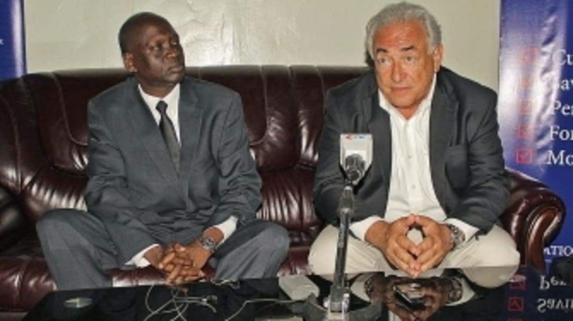 Former IMF chief landed in South Sudan on a two-day trip to open a new bank in the improvished country. He was greeted by Sudan's minister of commerce. (AFP)