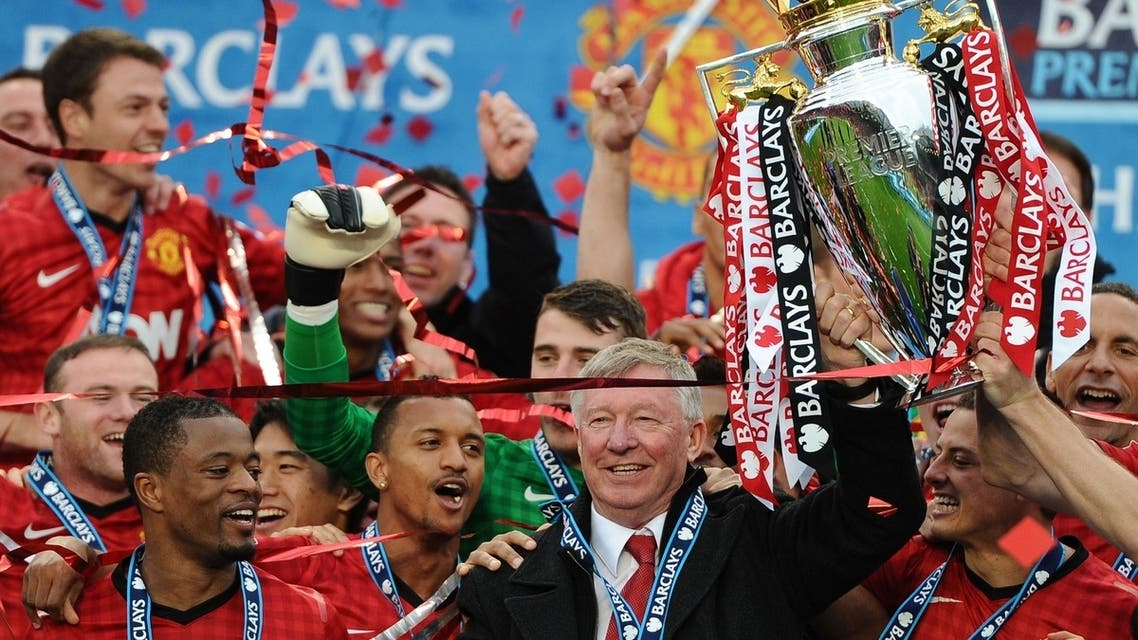 Manchester United's outgoing manager Alex Ferguson lifts the trophy as the EPL season draws to a close. The winner of the Middle East broadcast rights is yet to be decided. (AFP)