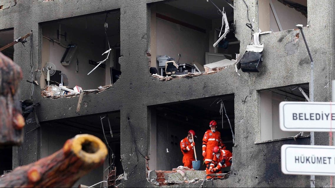 Search and rescue team members work on one of the scenes of the twin car bomb attacks in the town of Reyhanli of Hatay province near the Turkish-Syrian border May 12, 2013. (Reuters)