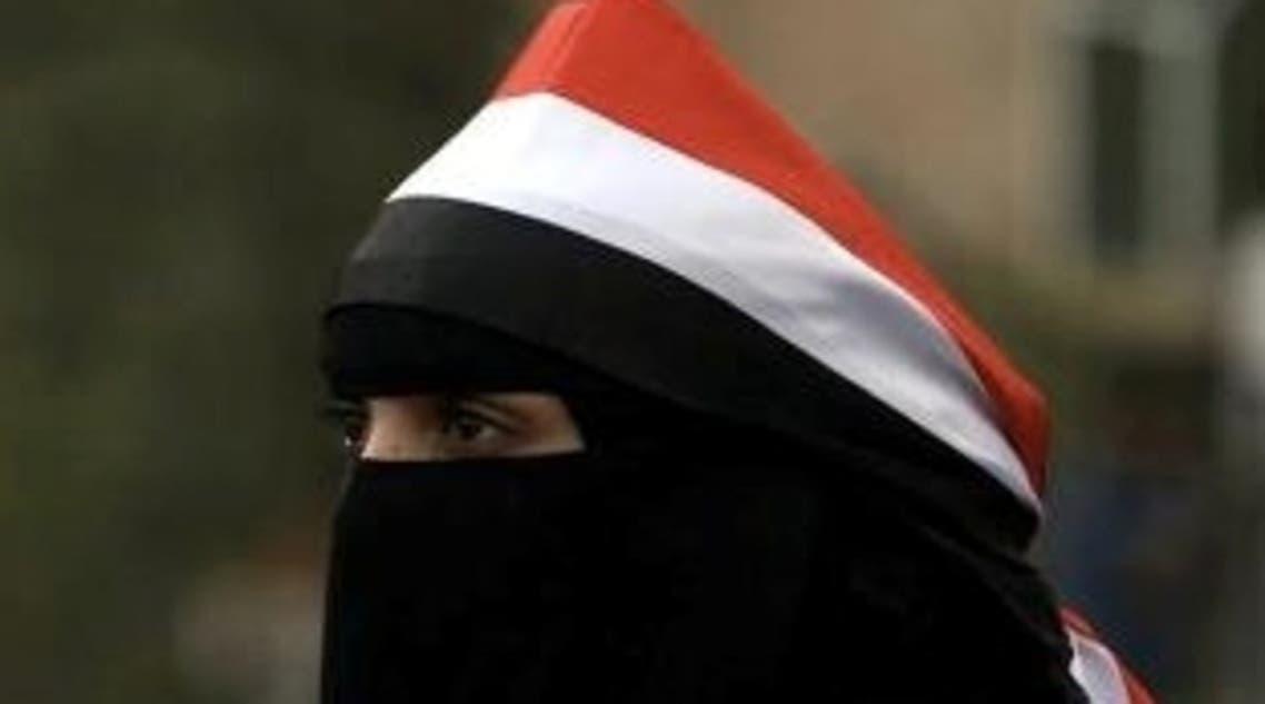 فتاة يمنية تشارك في اعتصام