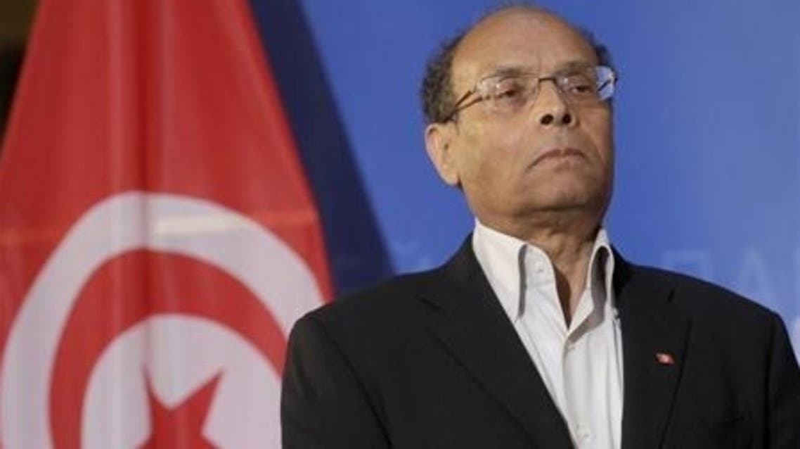 Tunisia's President Moncef Marzouki listens his national anthem at the European Parliament in Strasbourg, February 6, 2013. (Reuters)