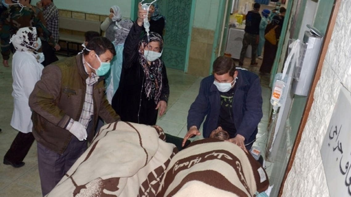 People are brought into a hospital in the Khan al-Assal region in the northern Aleppo province, as Syria's government accused rebel forces of using chemical weapons for the first time on March 19, 2013. (File photo: AFP)