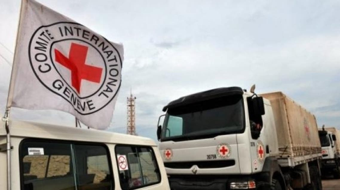 International Red Cross vehicles wait in convoy in 2011. Yemeni tribesmen released three kidnapped employees, sources said. (AFP file photo)