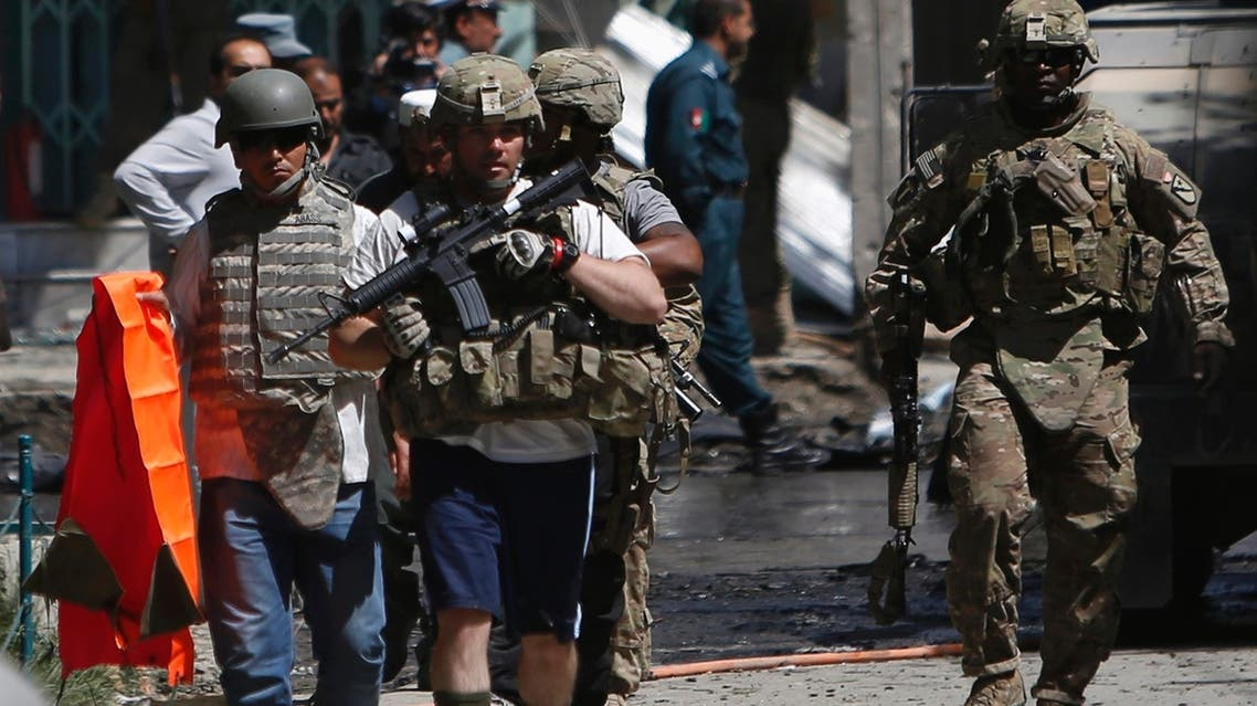 NATO soldiers with the International Security Assistance Force (ISAF) arrive at the site of a suicide attack in Kabul May 16, 2013. (REUTERS)
