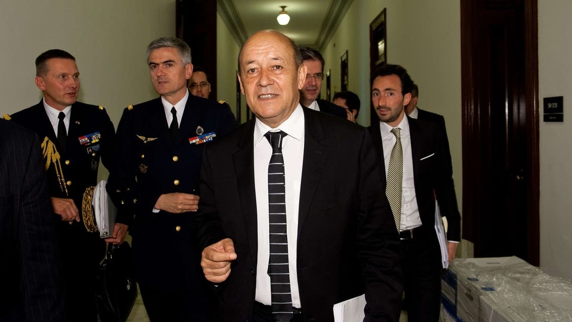 French Defense Minister Jean-Yves Le Drian leaves a US Senate Armed Services Committee informal. (AFP)