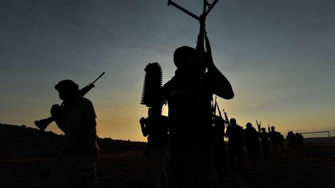 Members of a Syrian Jihadist group train. (AFP)