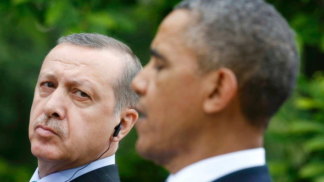Turkish Prime Minister Recep Tayyip Erdogan (L) listens to U.S. President Barack Obama during a joint news conference in the White House Rose Garden in Washington, May 16, 2013. (Reuters)