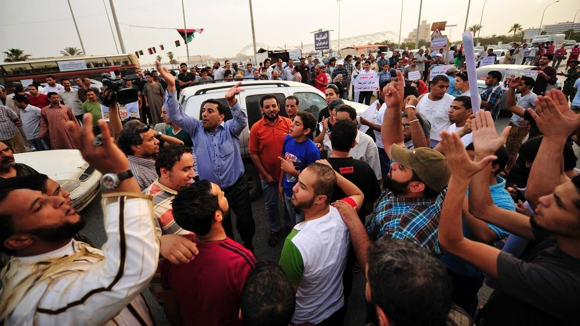 People demonstrate to demand the country's National Congress and transitional government ensure the police and the army carry out their jobs, and that militias are dismantled, in Benghazi May 17, 2013. (Reuters)