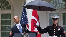 'Got an umbrella?' Obama in media storm after rain incident