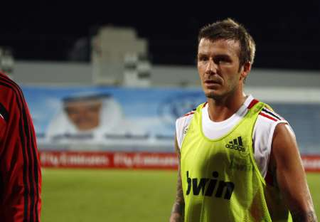 Italian soccer club AC Milan's new loan signing David Beckham walks off the pitch after his first training session with the team at Al Nasr Stadium in Dubai, December 30, 2008. (Reuters)