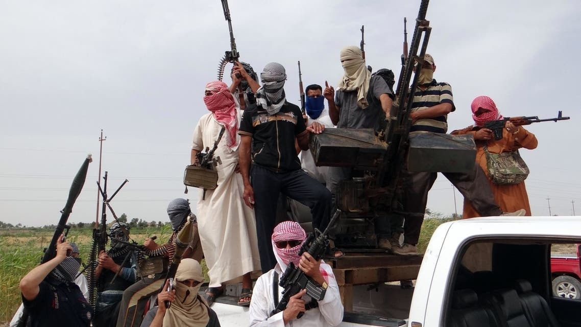 raqi armed tribesmen pose for a picture on the back of a truck in a road north of Ramadi, on May 18, 2013. The area is one of the main centres of the Sunni protest movement in Iraq. (AFP)