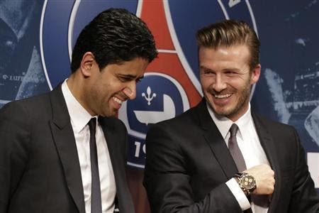 Soccer player David Beckham (R) attends a news conference in Paris January 31, 2013. Beckham laughs alongside Nasser Al-Khelaifi (L), Paris St Germain's club owner. (Reuters)