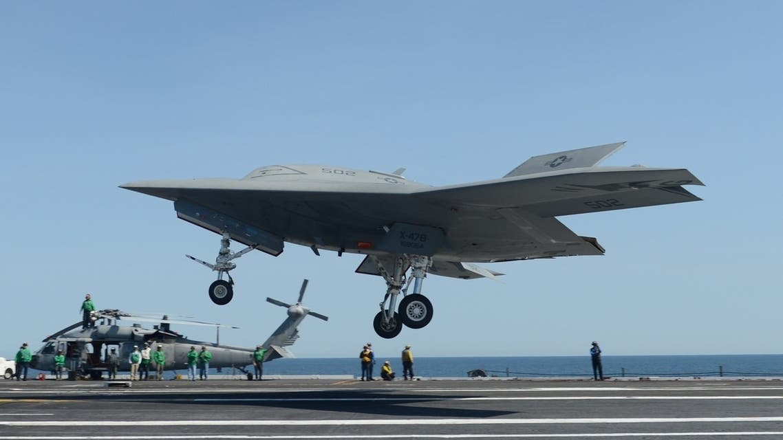 This photo released by the US Navy shows an X-47B unmanned combat air system (UCAS) demonstrator preparing to execute a touch and go landing on May 17, 2013. (AFP)