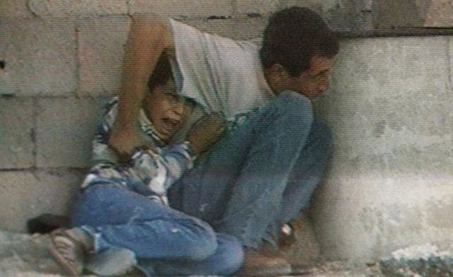 A TV grab from France 2 footage shot in 2000 in the Gaza Strip shows Jamal al-Dura and his son Mohammed. (AFP)