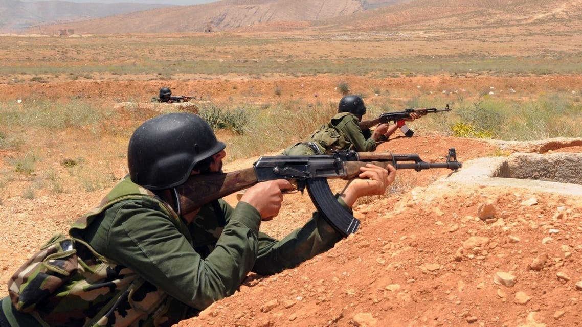 A handout picture released by the Syrian Arab News Agency (SANA) on May 22, 2013 shows Syrian government soldiers taking part in a training exercise at an undisclosed training camp in Syria. AFP