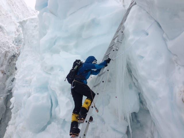 Moharrak crosses one of the many ladders in the legendary Khumbu Icefall. (Photo via Raha Moharrak)