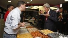 U.S.'s Kerry tucks into Palestinian shawarma and sweets