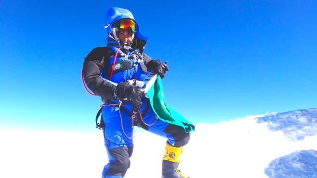 Moharrak stands on top of the world on Mount Everest. (Photo via Raha Moharrak)