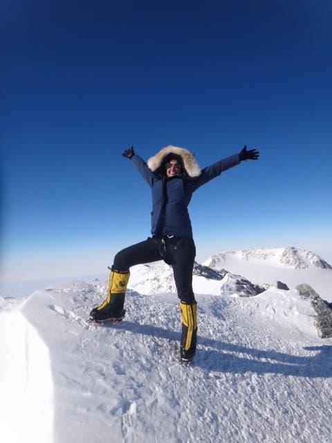 Moharrak celebrates on the summit on Mount Vinson in Antarctica. (Photo via Raha Moharrak)
