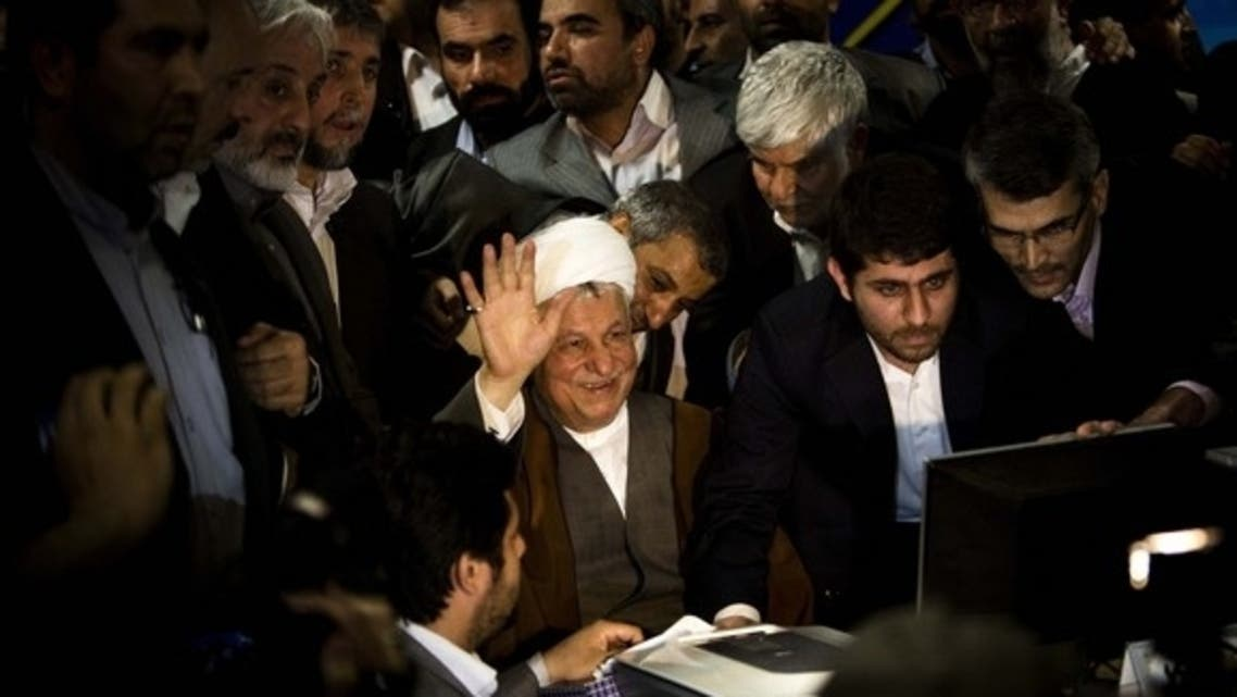 (AFP) Former Iranian President Akbar Hashemi Rafsanjani waves as he registers his candidacy for the June 14 presidential election at the Interior Ministry in Tehran, May 11, 2013.