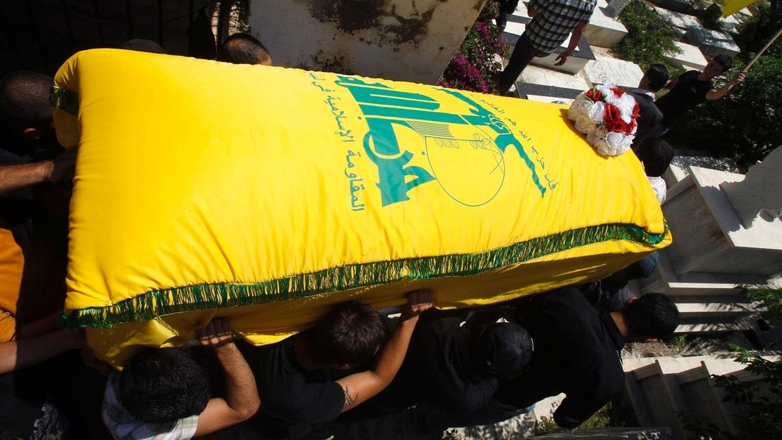Supporters of Hezbollah and relatives of Saleh Ahmed Sabagh, a Hezbollah member, carry the coffin during his funeral in the port-city of Sidon, southern Lebanon May 22, 2013. (Reuters)