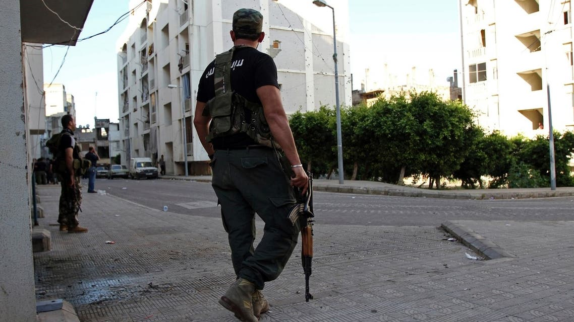 A Lebanese Sunni gunman holds a rifle in Al-Koubbeh, in Tripoli May 23, 2013.