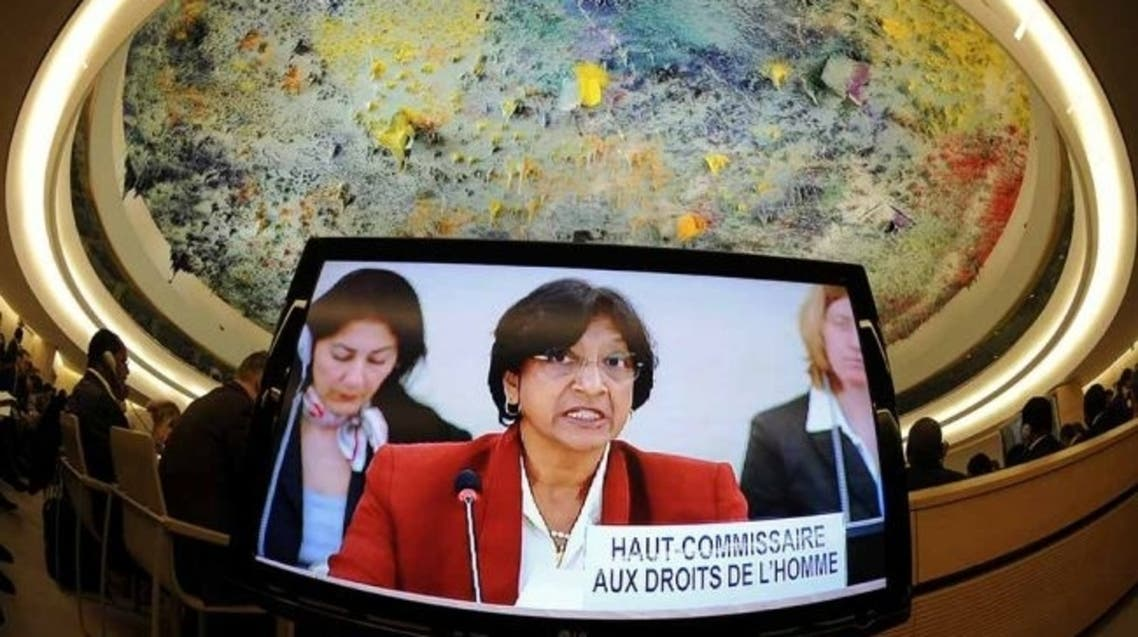 UN Commissioner for Human Rights Navi Pillay appears on a TV screen at the opening of a session of the United Nation Human Rights Council on February 27, 2012 in Geneva. AFP