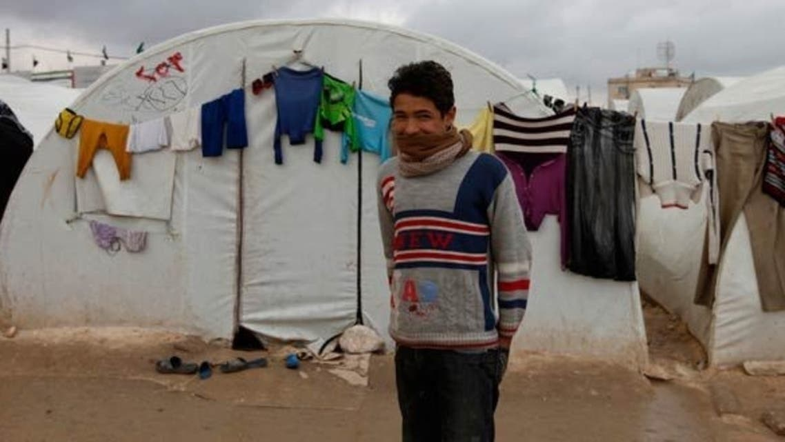 """Zaatari is located in the middle of the desert, not far from the Syrian border, and residents complain of shortages of water and electricity and describe the food as """"something even animals wouldn't eat."""" (REUTERS)"""