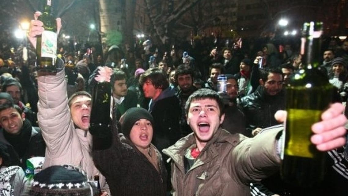 Protesters drink alcohol as they demonstrate in Ankara against restrictions on alcohol sales. (File Photo:AFP)