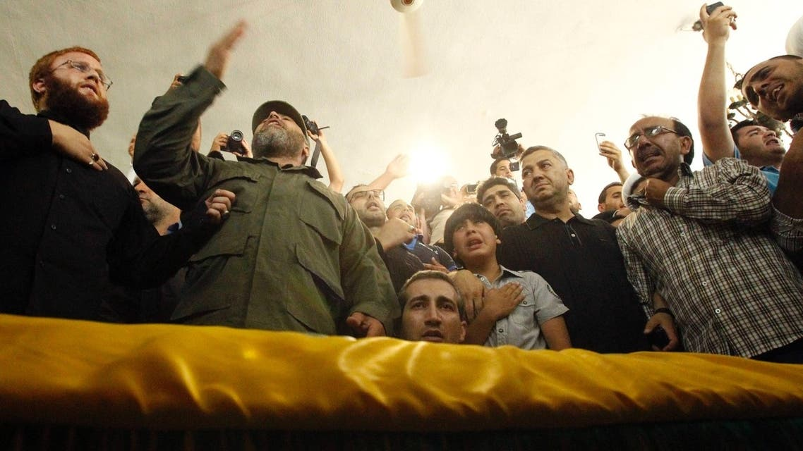 Supporters of Hezbollah and relatives of Hezbollah member Saleh Ahmed Sabagh mourn during his funeral in the port-city of Sidon, southern Lebanon May 22, 2013.