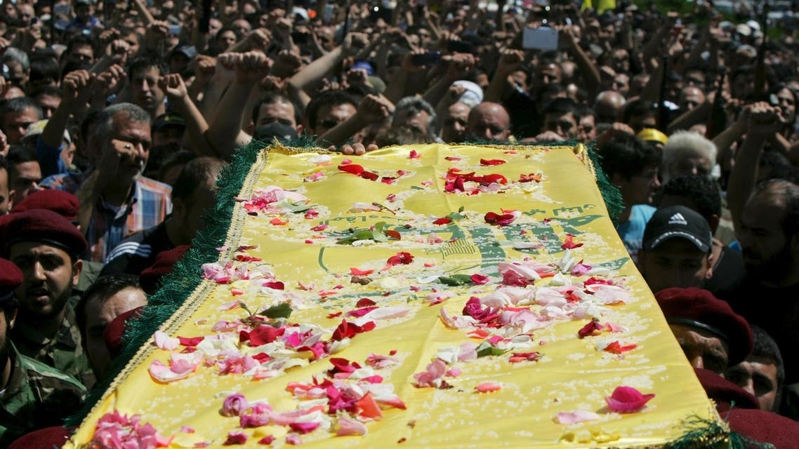 Supporters of Hezbollah and relatives of Hezbollah members attend the funeral of a Hezbollah fighter who died in the Syrian conflict in Ouzai in Beirut May 26