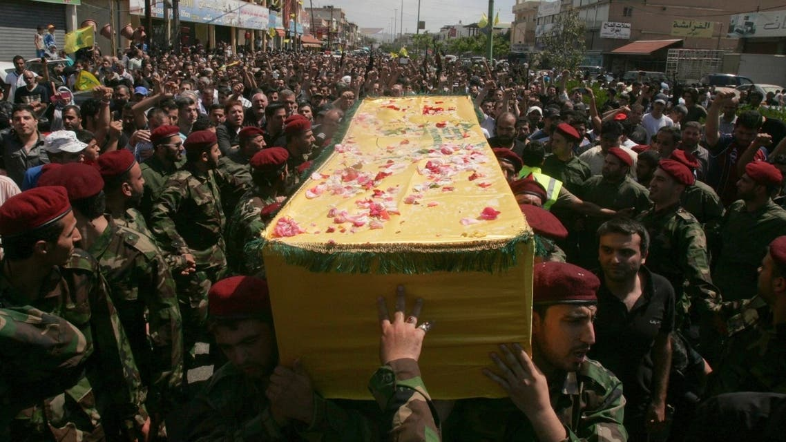 Supporters of Hezbollah and relatives of Hezbollah members attend the funeral of a Hezbollah fighter who died in the Syrian conflict in Ouzai in Beirut May 26, 2013. (Reuters)
