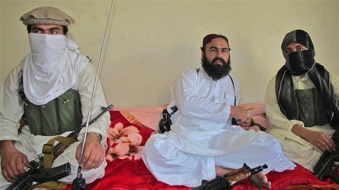 The drone striWali-ur-Rehman (C), deputy Pakistani Taliban leader, who is flanked by militants speaks to a group of reporters in Shawal town, that lies between North and South Waziristan region in the northwest bordering Afghanistan July 28, 2011. (Reuters) ke, reported by Pakistani security officials, was the first such attack since a May 11 general election. (File photo: Reuters)