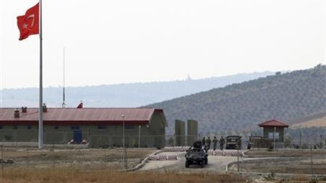 A Turkish armoured personnel carrier drives out of a military border post on the Turkish-Syrian border near the village of Hacipasa in Hatay province, southern Turkey October 9, 2012. (Reuters)